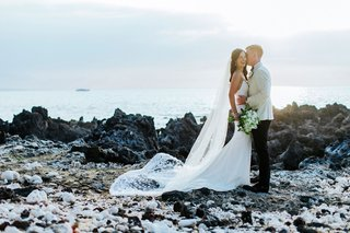 wedding-portrait-couple-photo-on-lava-rocks-big-island-hawaii-waimea-venue-crepe-dress-long-veil