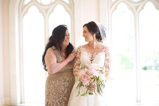 bride-in-illusion-wedding-dress-with-pink-green-bouquet-and-mother-of-bride-in-tan-dress-lace-detail