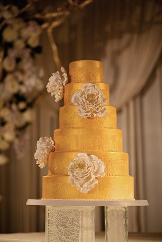 six-layer-cake-with-gilt-frosting-and-sugar-flowers