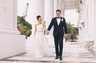 henry-morrison-flagler-museum-wedding-bride-in-romona-keveza-asymmetrical-gown-beaded-belt