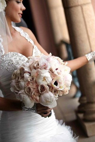 jeweled-bride-holding-rose-and-peony-flowers