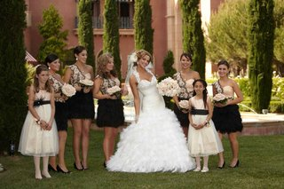 bridesmaids-in-pink-and-feather-black-gowns