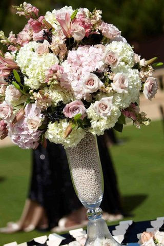 clear-fluted-vase-filled-with-pearls