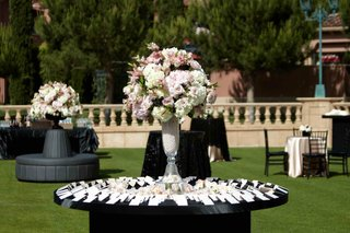 black-round-table-with-pearl-filled-vase