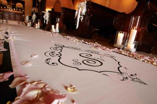 petal-lined-aisle-with-couples-wedding-monogram