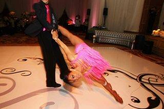 woman-being-spun-in-pink-fringe-dress