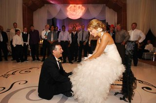 groom-on-floor-and-bride-sitting-on-chair