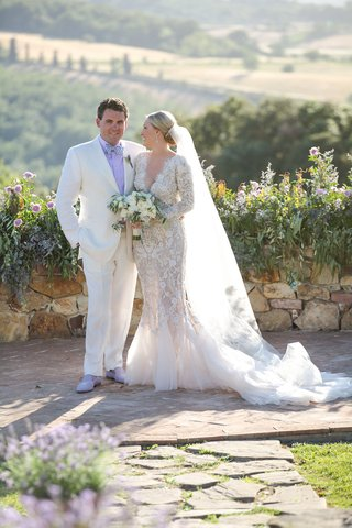 bride-in-marchesa-wedding-dress-long-sleeves-v-neck-mermaid-groom-in-white-tux-and-lavender-shirt