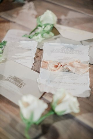 wedding-invitations-with-deckled-edges-and-a-blush-silk-ribbon