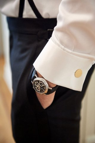 wedding-photo-detail-shot-getting-ready-groom-with-gold-black-watch-and-gold-cufflinks