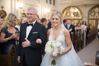 bride-in-wedding-dress-with-overskirt-with-father-razny-jewelers-family-wedding-ceremony-church