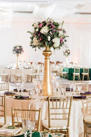 round-wedding-reception-table-tall-gold-centerpiece-white-hydrangea-pink-purple-rose-flowers-gold