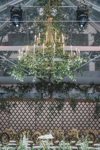 wedding-ceremony-alfresco-tented-wedding-with-chandelier-greenery-gold-guest-chairs-modern-luxury