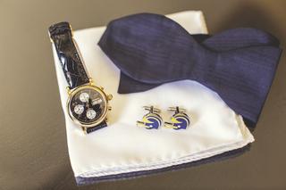 dark-blue-bow-tie-with-cufflinks-and-watch-on-handkerchief