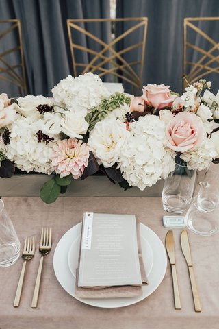 wedding-reception-place-setting-gold-flatware-flower-box-white-hydrangea-pink-rose-dahlia-burgundy