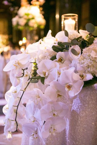 orchids-cascading-off-sweetheart-table-centerpiece-roman-catholic-wedding-reception-modern-white