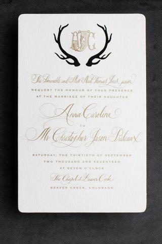 antlers-in-black-around-monogram-on-formal-invitation