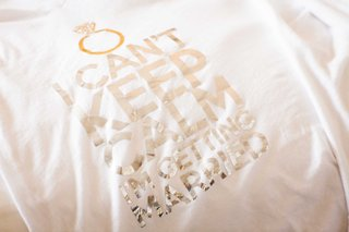 white-t-shirt-with-metallic-silver-lettering-reading-i-cant-keep-calm-im-getting-married-with-ring