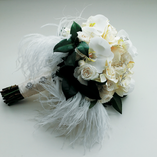 white-and-ivory-flowers-with-ostrich-feathers