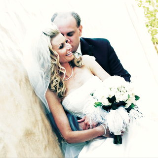 woman-in-strapless-gown-carrying-white-bouquet
