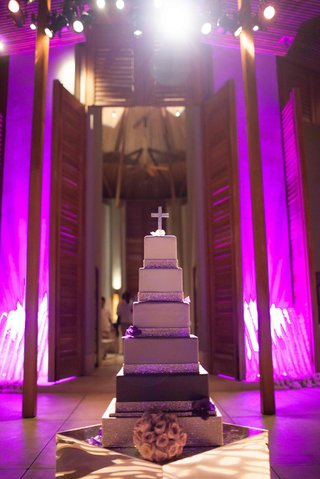 ombre-wedding-cake-with-silver-bands-and-crystal-cross-topper