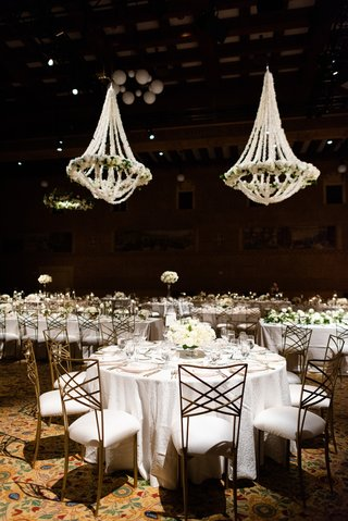 portland-art-museum-wedding-reception-with-chandeliers-completely-covered-in-white-orchids