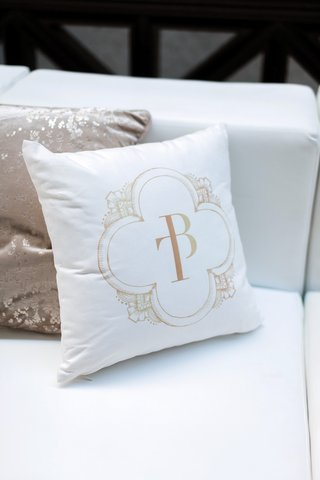wedding-reception-lounge-area-with-pillow-printed-with-custom-monogram-from-ceci-new-york