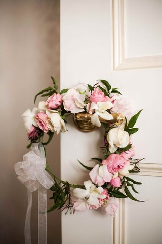 flower-headband-with-pink-and-white-roses-on-door-handle