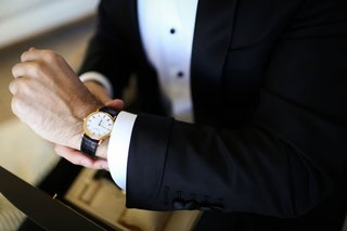 groom-in-tuxedo-black-buttons-black-and-gold-designer-watch
