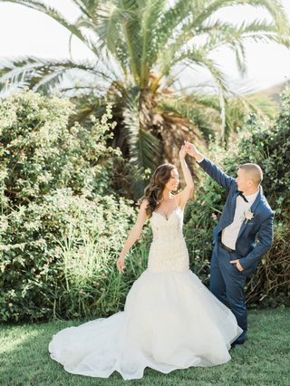 bride-in-trumpet-wedding-dress-mermaid-groom-in-navy-blue-suit-black-bow-tie