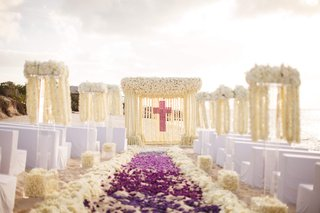 christian-cross-beach-wedding-with-purple-flowers