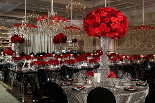 wedding-reception-ghost-chairs-black-chairs-red-rose-flowers-crystal-silver-linens-chandelier-damask