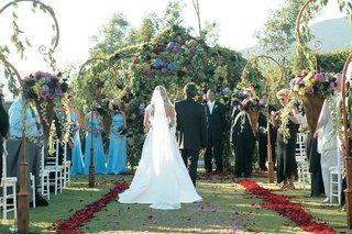 garden-ceremony-with-floral-archway-and-petals