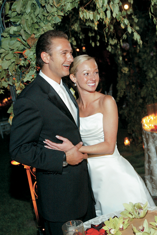 newlyweds-smiling-in-tuxedo-and-strapless-gown