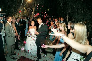 guests-throw-flowers-on-bride-and-groom