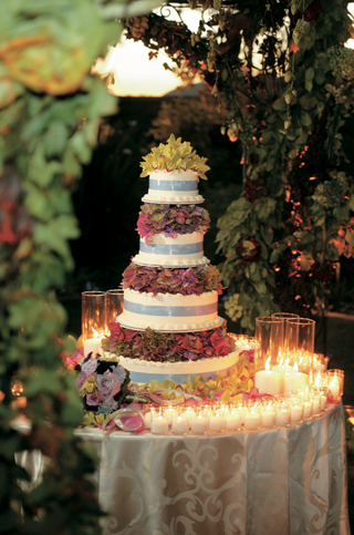 cake-table-linked-with-candles-and-flowers