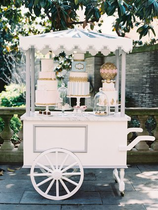 wedding-reception-paris-theme-dessert-pastry-cart-with-three-cakes-and-macaron-sphere-with-pastries
