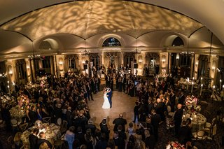 wedding-guests-surrounding-dance-floor-at-pleasantdale-chateau-wedding-venue-spotlight-on-couple