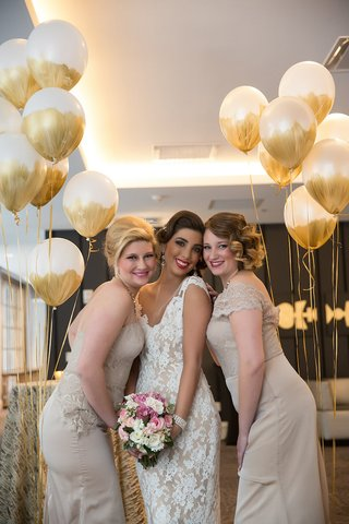 bride-in-lace-wedding-dress-with-bridesmaids-in-tan-mismatched-dresses