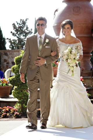 woman-in-fit-and-flare-wedding-dress-with-man-in-brown-suit