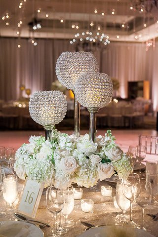 bejeweled-candles-low-floral-arrangements-classic-wedding-reception-roses-greenery-wine-glasses