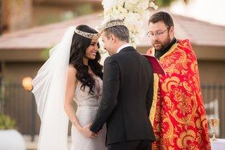 wedding-ceremony-armenian-wedding-tradition-rite-of-crowning-bride-in-galia-lahav-and-wedding-veil