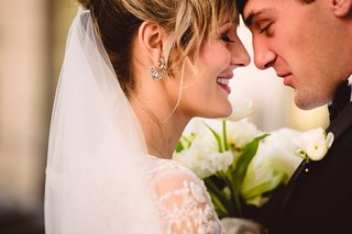 bride-in-monique-lhuillier-groom-touch-foreheads-during-first-look