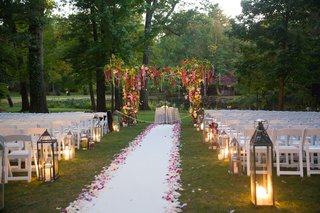 jewish-wedding-ceremony-outdoors-grass-white-aisle-runner-flower-petals-greenery-chuppah-with-pink