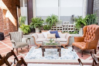 seating-area-with-vintage-furniture-leather-tufted-velvet-salvage-at-ceremony-space-wedding-ideas