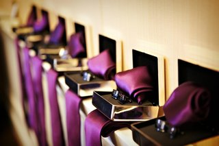 row-of-jewelry-boxes-with-purple-ribbon-and-cufflinks