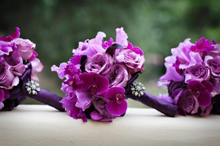 bright-purple-nosegays-with-orchid-rose-and-brooch