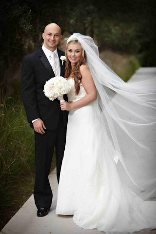wedding-portrait-full-length-with-tuxedo-groom-and-veil-bride