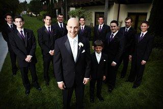 groom-with-ring-bearer-and-groomsmen-in-purple-ties