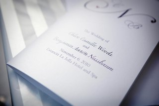wedding-ceremony-program-with-white-paper-and-purple-font